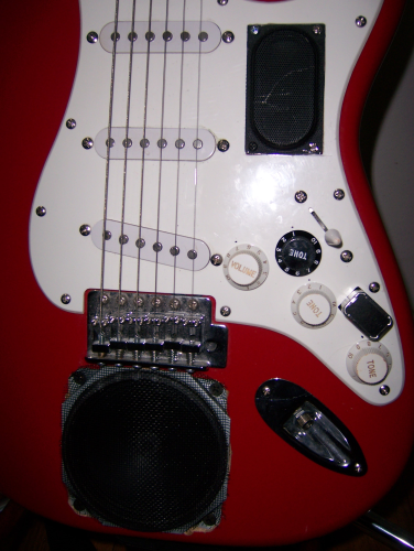 A guitar with two on-board speakers