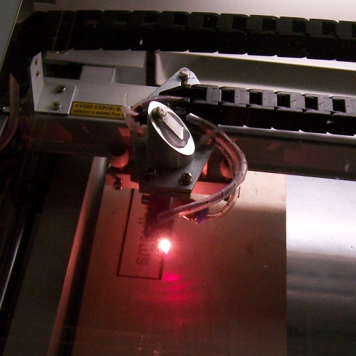 A laser cutter cutting out a piece of 3mm plywood